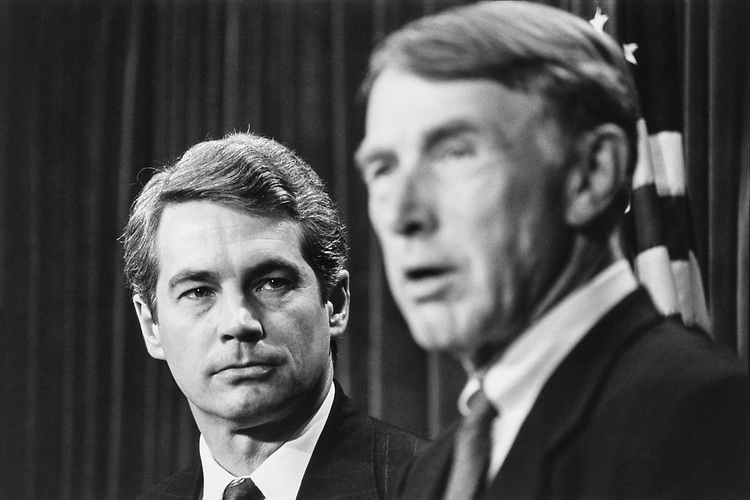 Rep. Dave McCurdy, D-Okla. listens to Rep. Martin Olav Sabo, D-Minn., at a press conference on term limitations for Committee Chairman/members. Rep. Dan Glickman, D-Kans. is also present on Nov. 26, 1991. (Photo by Maureen Keating/CQ Roll Call)