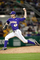 LSU Tigers pitcher Brent Bonnvillain #49 delivers a pitch against the Mississippi State Bulldogs during the NCAA baseball game on March 17, 2012 at Alex Box Stadium in Baton Rouge, Louisiana. The 10th-ranked LSU Tigers beat #21 Mississippi State, 4-3. (Andrew Woolley / Four Seam Images).