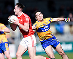 James Stewart of Louth  in action against Alan Sweeney of Clare during their national League game in Cusack Park. Photograph by John Kelly.