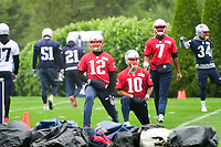 June 6, 2017: New England Patriots quarterback Tom Brady (12), quarterback Jimmy Garoppolo (10) and quarterback Jacoby Brissett (7) warm up at the New England Patriots mini camp held on the practice field at Gillette Stadium, in Foxborough, Massachusetts. Eric Canha/CSM