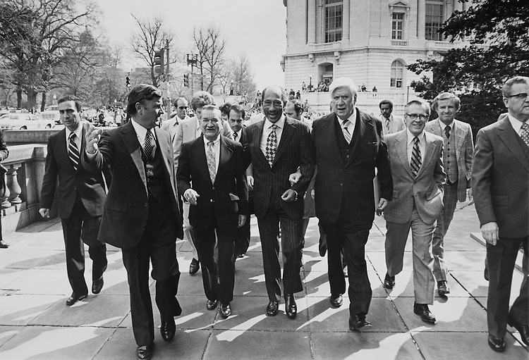 "Ken Hessing, Speaker of the House, Rep. Thomas Phillip ""Tip"" O'Neill, House Majority Leader, and  Leonard Bloomfield walk together. March 26, 1979 (Photo by Keith Jewell/CQ Roll Call)"