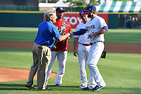 Buffalo Bisons pitcher Kyle Drabek (4) is presented the Judge Michael Dillon Comeback Player of the Year  Award during a ceremony as Raul Valdes and Ryan Schimpf look on before a game against the Pawtucket Red Sox on August 26, 2014 at Coca-Cola Field in Buffalo, New  York.  Pawtucket defeated Buffalo 9-3.  (Mike Janes/Four Seam Images)