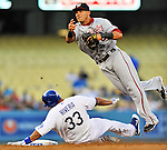 22 July 2011: Washington Nationals second baseman Ian Desmond gets a sliding Juan Rivera out at second but is unable to turn the double-play against the Los Angeles Dodgers at Dodger Stadium in Los Angeles, California. The Nationals defeated the Dodgers 7-2 in their first meeting of the 2011 season. Mandatory Credit: Ed Wolfstein Photo