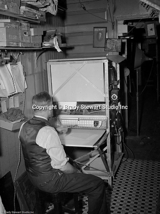 Pittsburgh PA:  Brady Stewart Sr drying Black and White photographic prints at the offices located at 812 Market Street in downtown Pittsburgh - 1950. At this time, Brady Stewart Studio was on the way to becoming the largest commercial photography studio in Western Pennsylvania.  The studio worked with nearly all the major advertising agencies, corporations and architects in Pittsburgh including; Ketchum McLeod and Grove, Lando Advertising, Brady Stewart started the business in 1912 and remained owner until his death in 1965.