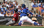 Arizona Diamondbacks' Nick Ahmed scores past Los Angeles Dodgers' Yasmani Grandal in a spring training game in Glendale, Ariz., on Friday, March 24, 2017.<br /> Photo by Cathleen Allison/Nevada Photo Source