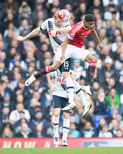 10.04.2016. White Hart Lane, London, England. Barclays Premier League. Tottenham Hotspur versus Manchester United. Tottenham Hotspur defender Eric Dier (15) and Manchester United midfielder Jesse Lingard (35) challenge for the header