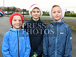 Members of Boyne A.C. Matthew and Alex Robertson and Luke McDonnell who took part in the Christmas Run at Lourdes Stadium in aid of Our Lady of Lourdes Hospital. Photo:Colin Bell/pressphotos.ie