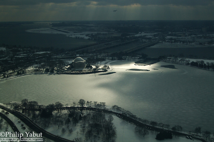 Looking south from the top of the Washington Monument, the Jefferson Memorial is surrounded by a frozen Tidal Basin and snow cover from the 1/26/11 storm.