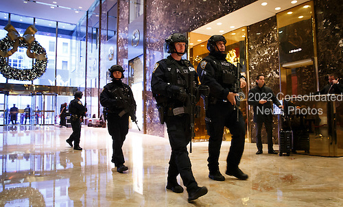 A group of New York City police officers pass through the lobby of Trump Tower in New York, New York, USA, 02 December 2016.<br /> Credit: Justin Lane / Pool via CNP