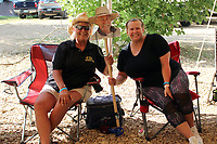 MEGAN DAVIS/MCDONALD COUNTY PRESS When Bill Pittman, of Kansas City, Mo., couldn't attend the 2019 Chicken Coop Open, his friends Karen Buchner (left) and Kelsey Snodgrass (right) of Columbia, Mo. saw to it that he was there in spirit.