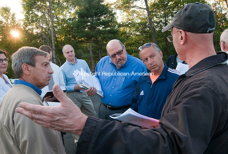 TORRINGTON, CT 18 SEPTEMBER 2014-091814JS06--Members of the Torrington High School turf committee, from left, facilities director Dave Bascetta; co-chair Ed Arum and co-chair Mario Longobucco listen to fellow member Andrew Nargi  during a progress meeting Thursday at the newly installed track and field complex. <br /> Jim Shannon Republican-American