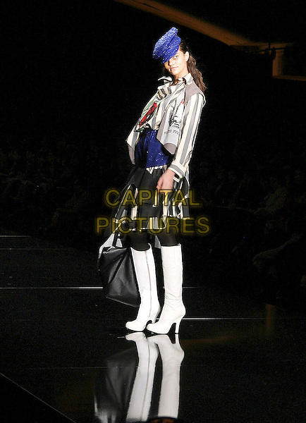 MODEL.Vivienne Westwood Ready to wear Autumn/ Winter Collection 2005/ 2006, Paris, March 1st 2005..full length catwalk fashion show white knee high boots blue hat.**UK SALES ONLY**.Ref: MDS.www.capitalpictures.com.sales@capitalpictures.com.©Virgille Beichy/O.Medias/Capital Pictures .