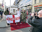 An England fan poses in front of Checkpoint Charlie before  the International Friendly match at Olympiastadion.  Photo credit should read: David Klein/Sportimage