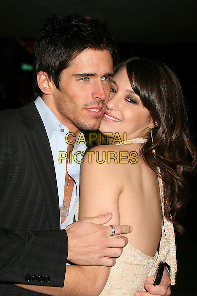 BRANDON BEEMER & CHRISSY GLICKMAN.Paramount - DreamWorks Official Golden Globes After Party at The Beverly Hilton Hotel, Beverly Hills, California, USA..January 15t, 2007.half length black suit jacket cream dress halterneck .CAP/ADM/BP.©Byron Purvis/AdMedia/Capital Pictures