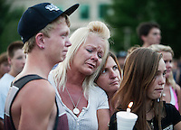 Hayden Raymond (cq, left), 15, and his mother Michelle Anderson (cq, blond hair), mourn for the 12 victims of the mass shooting at the Aurora Century 16 movie theater during a prayer vigil at the Aurora Municipal Center, in Aurora, Colorado, Sunday, July 22, 2012. Suspect James Holmes, allegedly went on a shooting spree and killed 12 people and injured 59 during an early morning screening of 'The Dark Knight Rises.'..Photo by MATT NAGER