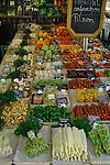 Fresh salad vegetables on market stall in vegetable market. Viktualienmarkt, Munich, Germany.
