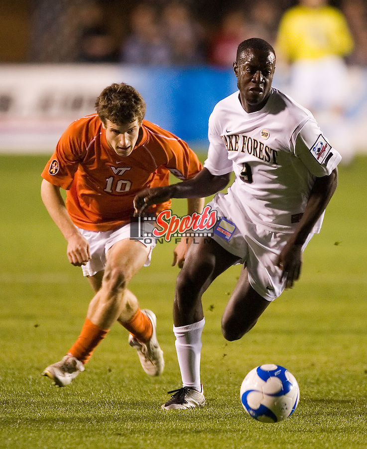 Marcus Tracy (9) of the Wake Forest Demon Deacons dribbles past Charles Campbell (10) of the Virginia Tech Hokies during semi-final action of the 2007 NCAA Men's College Cup at SAS Soccer Park in Cary, NC, Friday, December 14, 2007.  The Demon Deacons defeated the Hokies 2-0 to advance to the finals versus Ohio State.