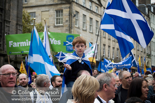 A young boy waving a flag as crowds march down the Royal Mile during a pro-Independence march and rally in the Scottish capital. The event, which was staged in support of the pro-Independence movement, was attended by an estimated by approximately 30,000 people. The referendum to decide whether Scotland will become an independent nation will be staged on 18th September 2014.