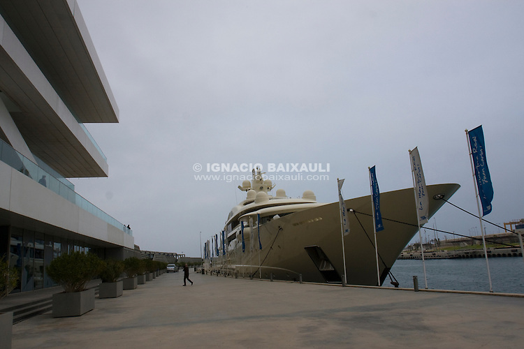 Dilbar Yacth in Valencia beside Veles e Vents build, Port America's Cup, Valencia.Vessel: Dilbar.IMO num.: 9526758.MMSI num: 319526000.Flag: Cayman Islands.Type of ship : Yacht.Year of build : 2008.Dimensions (length x beam x draught): 110 x 16 x.Call Sign : ZCXS9.Gross tonnage : 4100.Shipbuilder : Lürssen (Germany).