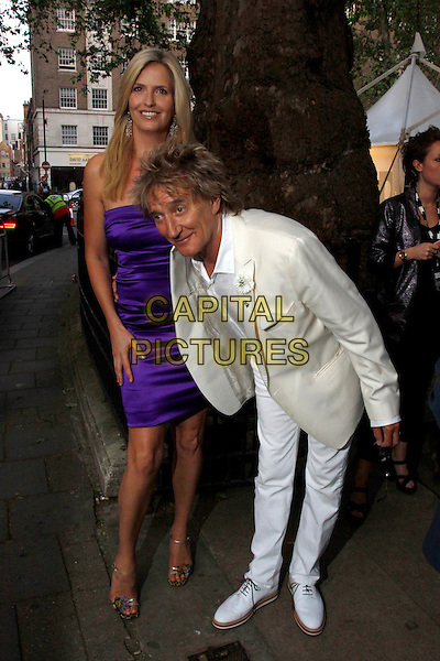 Penny Lancaster and Rod Stewart.Arrivals at the Glamour Women Of The Year Awards, Berkeley Square Gardens, London, England..May 29th, 2012.full length white suit shirt purple strapless dress silk satin married husband wife bending leaning bow bowing .CAP/AH.©Adam Houghton/Capital Pictures.