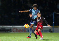 Sido Jombati of Wycombe Wanderers battles George Thomas of Coventry City during the The Checkatrade Trophy Southern Group D match between Wycombe Wanderers and Coventry City at Adams Park, High Wycombe, England on 9 November 2016. Photo by Andy Rowland.