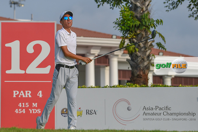 Won-Jun LEE (KOR) watches his tee shot on 12 during Rd 2 of the Asia-Pacific Amateur Championship, Sentosa Golf Club, Singapore. 10/5/2018.<br /> Picture: Golffile | Ken Murray<br /> <br /> <br /> All photo usage must carry mandatory copyright credit (© Golffile | Ken Murray)