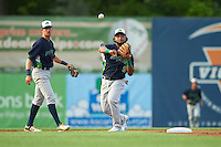 Vermont Lake Monsters second baseman Jesus Lopez (9) throws to first base as shortstop Eli White (27) backs up the play during a game against the Auburn Doubledays on July 12, 2016 at Falcon Park in Auburn, New York.  Auburn defeated Vermont 3-1.  (Mike Janes/Four Seam Images)