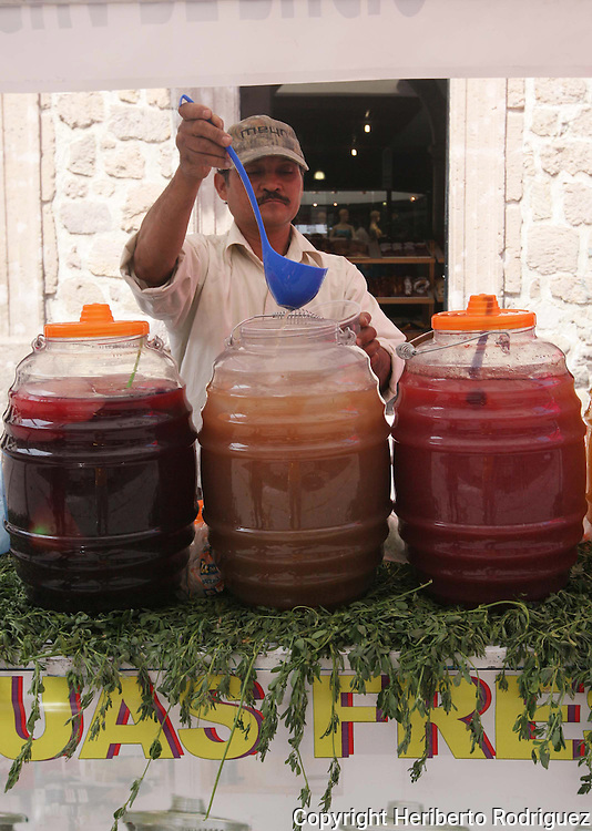 A Mexican vendor sells fresh fruit waters in a street stand in morelia city, in western state of Michoacan, April 3, 2010. Photo by Heriberto Rodriguez
