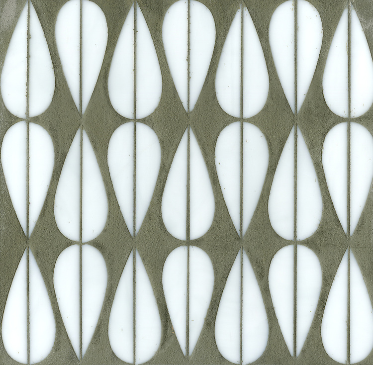 Mod Drops, a glass waterjet mosaic shown in Moonstone, is part of the Erin Adams Collection for New Ravenna.