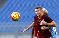 Calcio, Serie A: Roma vs Lazio. Roma, stadio Olimpico, 8 novembre 2015.<br /> Roma's Edin Dzeko, left, is challenged by Lazio's Dusan Basta during the Italian Serie A football match between Roma and Lazio at Rome's Olympic stadium, 8 November 2015.<br /> UPDATE IMAGES PRESS/Riccardo De Luca