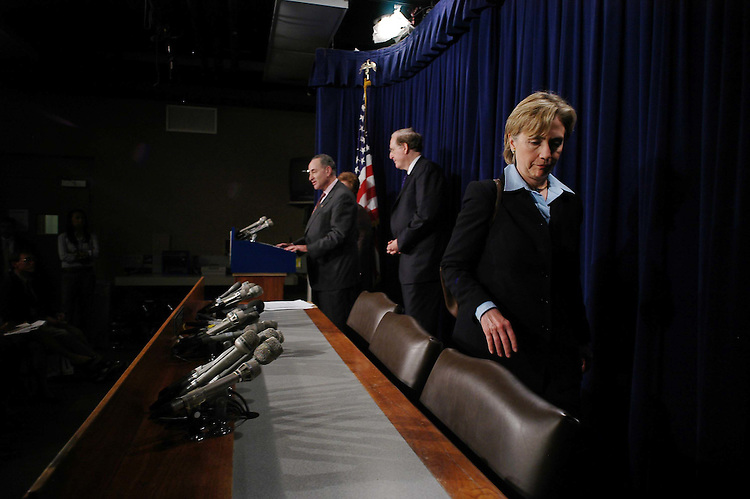 01/19/06.MEDICARE--Sen. Hillary Rodham Clinton, D-N.Y., leaves a news conference on Medicare early as Sen. Charles E. Schumer, D-N.Y., and Sen. John D. Rockefeller IV, D-W.Va., finish up..CONGRESSIONAL QUARTERLY PHOTO BY SCOTT J. FERRELL