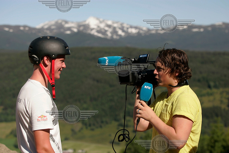 The winner of the slopestyle competititon is interviewed by television reporter.The Extremesport Week, Ekstremsportveko, is the worlds largest gathering of adrenalin junkies. In the small town of Voss enthusiasts in a varitety of extreme sports come togheter every summer to compete and play. Norway..©Fredrik Naumann/Felix Features.