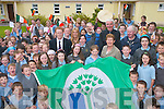 Teachers and pupils help Kerry football star Colm Cooper raise their Green Flag in the school last Friday. Oncluded in picture are Nora Mai Kelliher (Principal), Moira Cronin (Green Team Teacher), Bertie OConnor (Teacher), Pat Horgan (Parents Committee) and Richard Tuohy (School Caretaker)..
