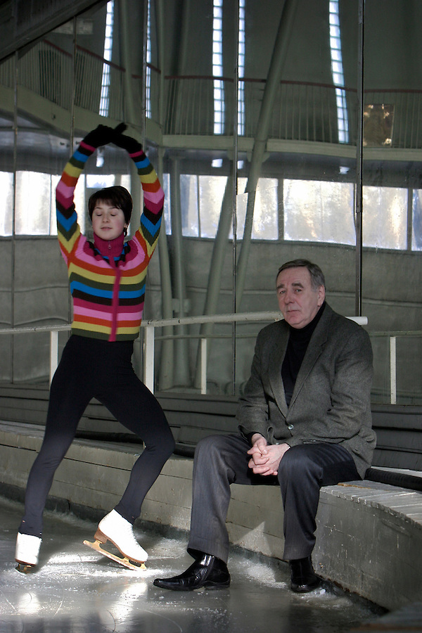 Moscow, Russia, 20/02/2004..Chief coach Vladimir Sadikov and world champion skater Irina Slutskaya in the training hall at the SUP [Trade Union Moscow] club..
