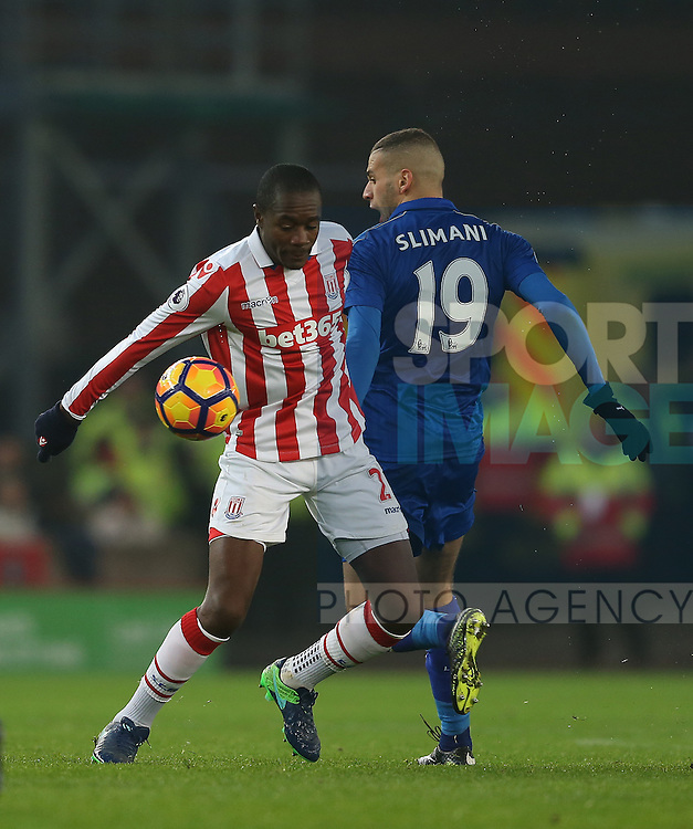 Gianelli Imbula of Stoke City  and Islam Slimani of Leicester City during the English Premier League match at the Bet 365 Stadium, Stoke on Trent. Picture date: December 17th, 2016. Pic Simon Bellis/Sportimage