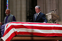 Former President George W. Bush touches the casket of his father, former President George H.W. Bush, at the State Funeral at the National Cathedral, Wednesday, Dec. 5, 2018, in Washington. <br /> CAP/MPI/RS<br /> &copy;RS/MPI/Capital Pictures