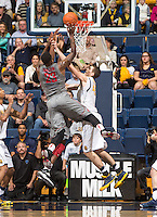 David Kravish of California tries to block the ball away from D.J. Shelton of Washington State during a game at Haas Pavilion in Berkeley, California on January 5th, 2014. California defeated Washington State 76 - 55