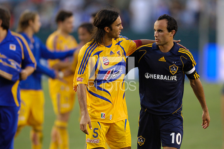 Los Angeles Galaxy Landon Donovan (10) and  Tigres UNAL (5) Fabian Cubero talk after the game during the World Series of Football at the Home Depot Center in Carson, CA on Tuesday, July 17, 2007. (Photo by Matt A. Brown)