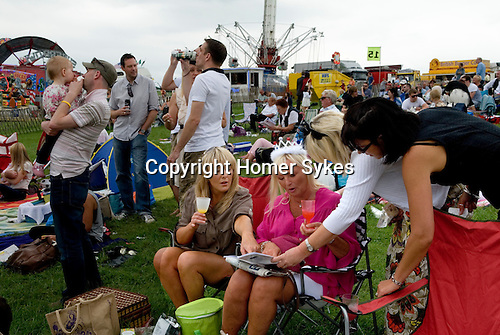 Ladies Day at The Derby horse race. Epsom Down Surrey UK. (l-r) Nina Callan and her auntie Deana Marshall wearing a royal crown to celebrate Queen Elizabeth's diamond jubilee. Plus two friends all from Epsom. On the Hill.