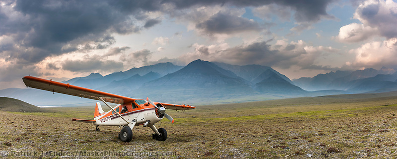 Pilot dirk nickisch with coyote air and his de-havilland beaver bush plane on tundra tires in the Brooks Range, Arctic, Alaska.