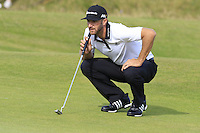 Dustin Johnson (USA) lines up his putt on the 14th green during Thursday's Round 1 of the 145th Open Championship held at Royal Troon Golf Club, Troon, Ayreshire, Scotland. 14th July 2016.<br /> Picture: Eoin Clarke | Golffile<br /> <br /> <br /> All photos usage must carry mandatory copyright credit (&copy; Golffile | Eoin Clarke)