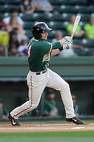 Shortstop Justin Bohn (14) of the Greensboro Grasshoppers bats in a game against the Greenville Drive on Wednesday, May 7, 2014, at Fluor Field at the West End in Greenville, South Carolina. Greenville won, 12-8. (Tom Priddy/Four Seam Images)