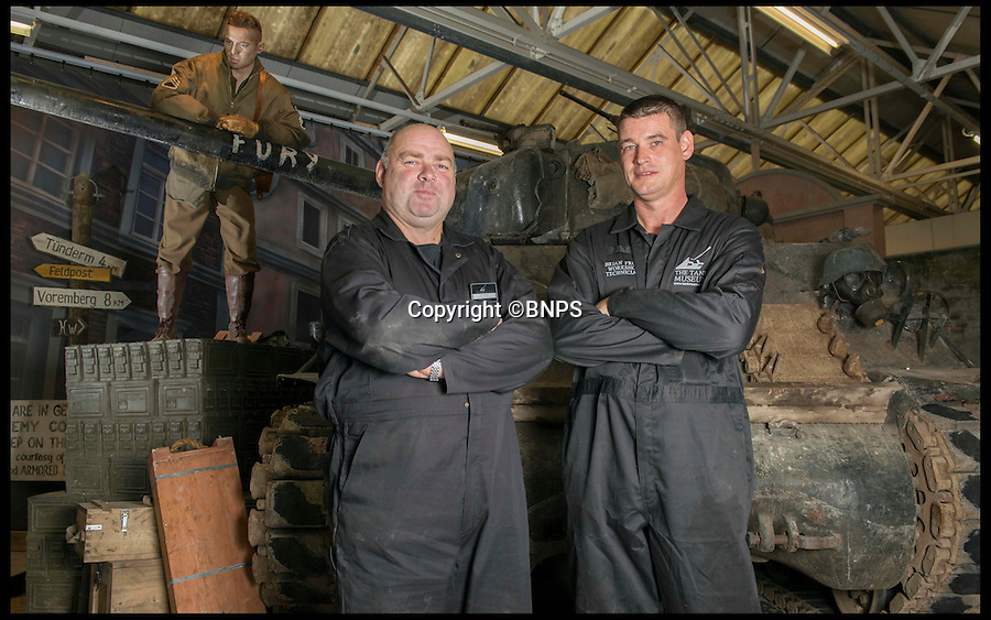 BNPS.co.uk (01202 558833)<br /> PIc: LauraDale/BNPS<br /> <br /> Workshop technicians (L-R) Ian (Buzz) Aldridge (53) and Brian Frost (39) with 'Fury'.<br /> <br /> Meet the real driving force behind Brad Pitt's new Second World War blockbuster, Fury.<br /> <br /> Tank mechanics Brian Frost, 39, and Ian 'Buzz' Aldridge, 53, were hired to drive the famous Sherman tank the movie is named after for most of the major scenes.<br /> <br /> The pair, who work at Bovington Tank Museum in Dorset, spent six months taking it in turns to operate the 26 ton tank in front of the cameras.<br /> <br /> Although the two never appear in the movie, every time 'Fury' is seen in motion and without actor Michael Pena in the driving seat,<br /> Brian or Buzz are at the controls.<br /> <br /> The pair also trained actor Pena the basics of driving the Sherrman tank to give the close-up shots of his character Corporal Trini 'Gordo' Garcia more legitimacy.<br /> <br /> The museum lent the movie's producers their M4 Sherman tank to act as Fury as well as the services of Brian and Buzz.