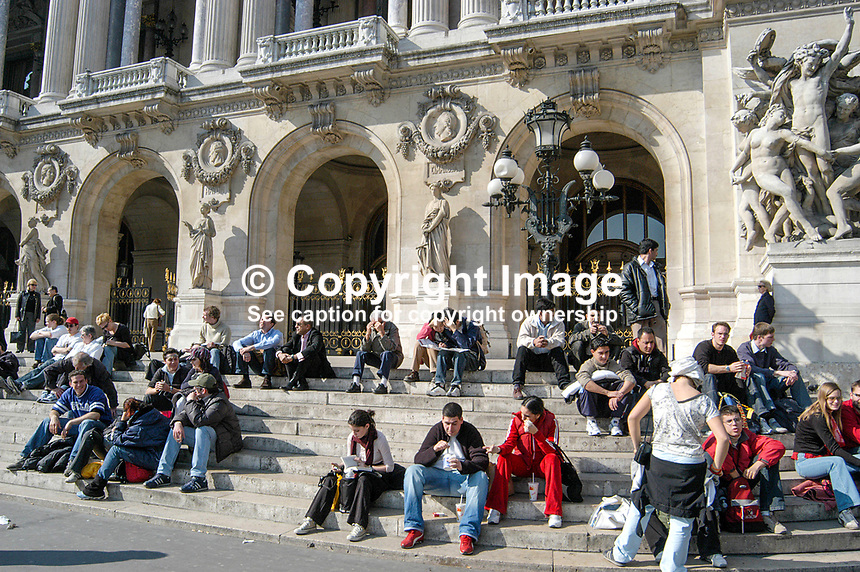 The steps of the Opera Garnier is a popular rendez-vous and resting place in Paris, France. Ref: 200403294226.<br /> <br /> Copyright Image from Victor Patterson,<br /> 54 Dorchester Park, <br /> Belfast, UK, BT9 <br /> <br /> t1: +44 28 9066 1296 (from Rep of Ireland 048 90661296)<br /> t2: +44 28 9002 2446 (from Rep of Ireland 048 9002 2446)<br /> <br /> m: +44 7802 353836<br /> <br /> e: victorpatterson@me.com<br /> www.victorpatterson.com<br /> <br /> Please see my Terms and Conditions of Use at www.victorpatterson.com. It is IMPORTANT that you familiarise yourself with them.<br /> <br /> Images used on the Internet must be visibly watermarked i.e. &copy; Victor Patterson<br /> within the body of the image and copyright metadata must not be deleted. Images <br /> used on the Internet have a size restriction of 4kbs and will be chargeable at current<br />  NUJ rates unless agreed otherwise.<br /> <br /> This image is only available for the use of the download recipient i.e. television station, newspaper, magazine, book publisher, etc, and must not be passed on to any third <br /> party. It is also downloaded on condition that each and every usage is notified within 7 days to victorpatterson@me.com<br /> <br /> The right of Victor Patterson to be identified as the author is asserted in accordance with The Copyright Designs And Patents Act (1988). All moral rights are asserted.