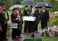 Pictured: An undertaker carries the coffin of baby Sion at the burial site at Thornhill Cemetery, Cardiff, Wales, UK. Tuesday 28 June 2016<br /> Re: The funeral of Sion, the baby boy found dead in the River Taff in Cardiff has taken place<br /> Generous locals raised nearly &pound;1,400 for the memorial after reading about plans to hold a fitting ceremony for the newborn baby whose body was discovered in Cardiff a year ago.<br /> The funeral took place at the Briwnant Chapel at Thornhill Crematorium, Cardiff. Members of the public are invited to be among the congregation.