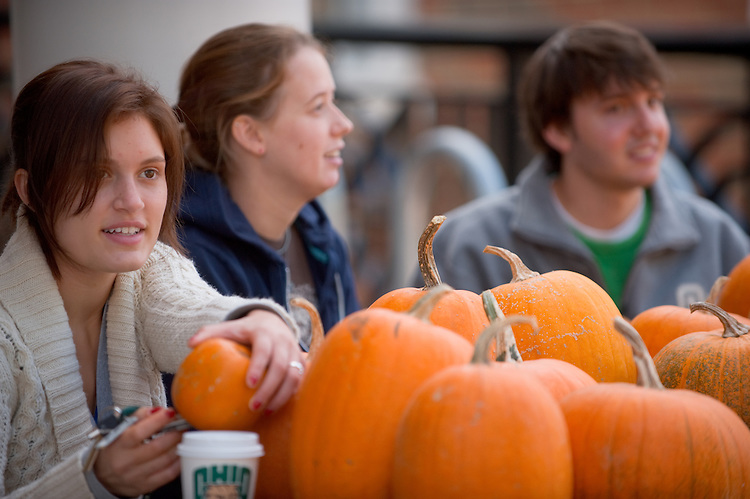 19074Students on Campus Fall..Left to right:...Natalie Mercuri(white sweater), Kacey Bruce, and Any Phillips..Selling pumpkins to raise money for Multimedia Association