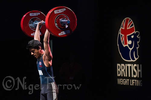 10 MAY 2014 - COVENTRY, GBR - Jaswant Shergill from Oldbury Academy attempts to hold a lift during the men's 62kg category round at the British 2014 Senior Weightlifting Championships and final 2014 Commonwealth Games qualifying event round at the Ricoh Arena in Coventry, Great Britain. Shergill's combined total for the event of 240kgs makes him eligible for selection for the England team for the Commonwealth Games in Glasgow (PHOTO COPYRIGHT © 2014 NIGEL FARROW, ALL RIGHTS RESERVED)