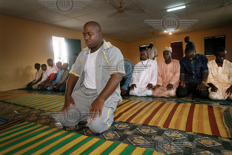 Mujahid Dokubo-Asari, leader of the Niger Delta Peoples' Volunteer Force (NDPVF), prays in the local mosque after a rally in Elele. Asari's group are fighting for resource control and independence on behalf of the ethnic Ijaw population.
