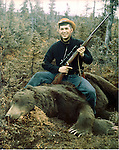 Ron Bennett Photographer and the grizzly bear he shot.  Ronald T. Bennett Photojorunalist and the grizzly bear he shot.