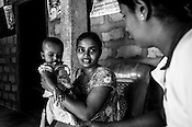 Mathumita (right) speaks with Sugandhini (30) and her 9 month daughter, Rutsika during the field visits in Punaineeravi village in Kilinochchi in Northern Sri Lanka. Photo: Sanjit Das/Panos